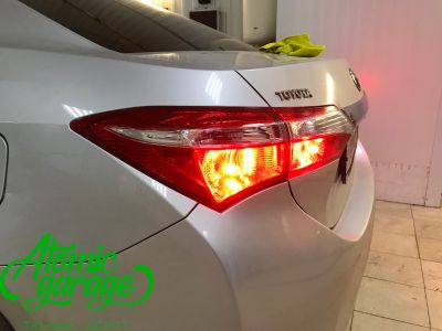 Toyota Corolla E180, установка линз Bi-led Optima Professional и Led ПТФ - фото 28