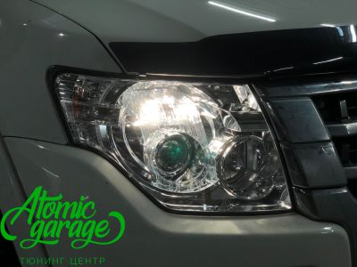 Mitsubishi Pajero 4, замена линз на Bi-led Optima Pro - фото 5