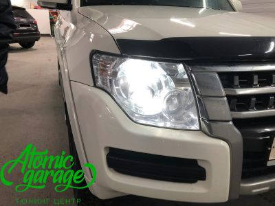 Mitsubishi Pajero 4, замена линз на Bi-led Optima Pro - фото 1