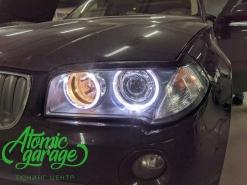 BMW X3 E83, установка линз Bi-led Diliht Triled + Led ангельские кольца